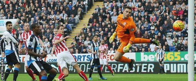 Aleksandar Mitrovic (left) watches as his header comes back off the post