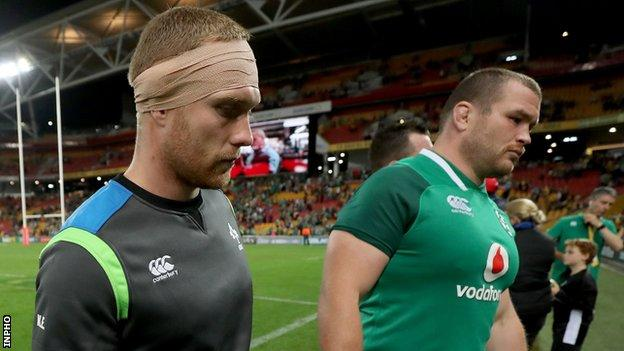 Keith Earls (left) with Jack McGrath after Ireland's defeat in Brisbane