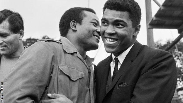 Muhammad Ali visits Jim Brown on the set of The Dirty Dozen in Hertfordshire in 1966