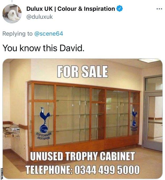 A since deleted tweet sent by the official Dulux account with a mocked-up advert for an unused trophy cabinet with the Spurs logo overlaid on the image