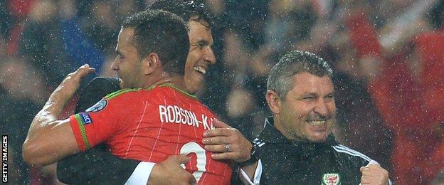 Coleman and Hal Robson-Kanu embrace after Wales beat Belgium