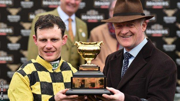 Trainer Willie Mullins and jockey Paul Townend lift the Gold Cup
