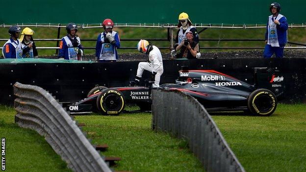environment Fernando Alonso gets out of his McLaren during qualifying for the Brazilian Grand Prix in 2015