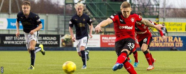 Rangers' Martyn Waghorn strikes his stoppage-time penalty