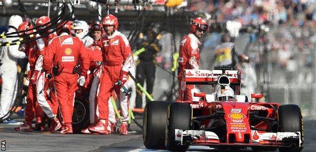 Ferrari's Sebastian Vettel leaves the pit lane