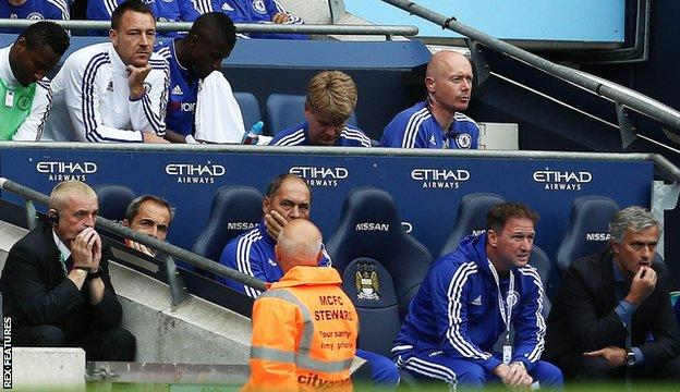 John Terry watches on from the subs' bench at Manchester City