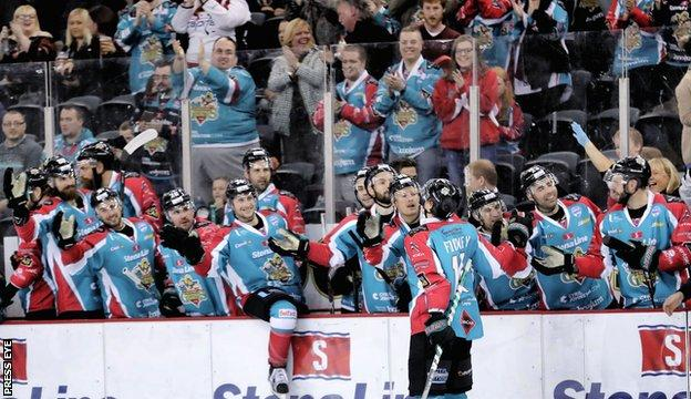 Michael Forney celebrates after scoring a penalty shot for Belfast against Coventry