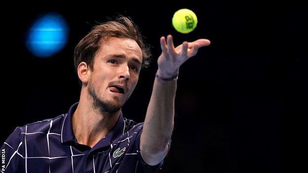 Daniil Medvedev serves in his ATP Finals win against Alexander Zverev