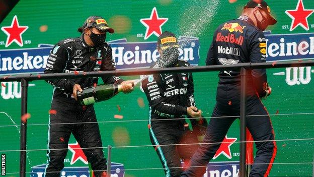 Hamilton, Bottas and Verstappen spray champagne on the podium