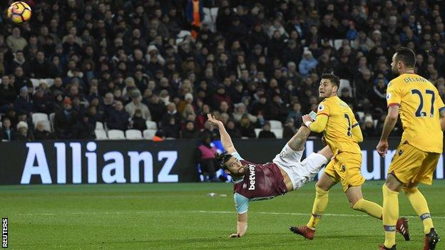 Andy Carroll, who had an excellent all-round game, scores with a stunning mid-air volley