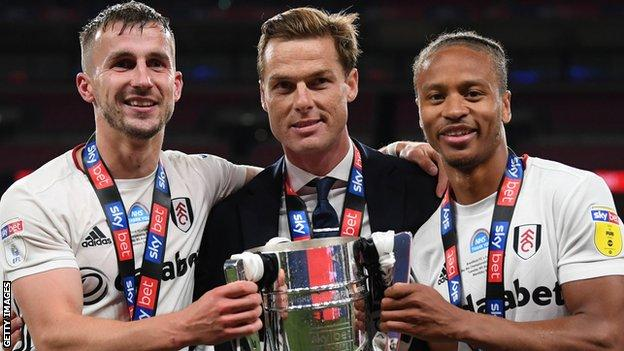 Joe Bryan, Scott Parker and Bobby Decordova-Reid with the Championship play-off final trophy