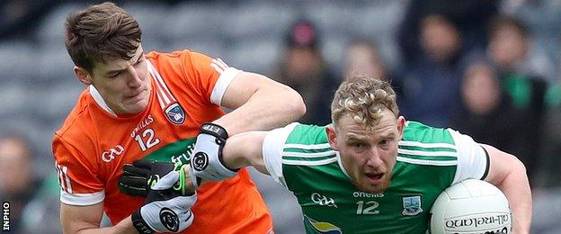 Armagh's Niall Grimley battles with Fermanagh's Aidan Breen