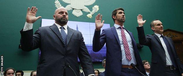 Adam Nelson, Michael Phelps and Travis Tygart