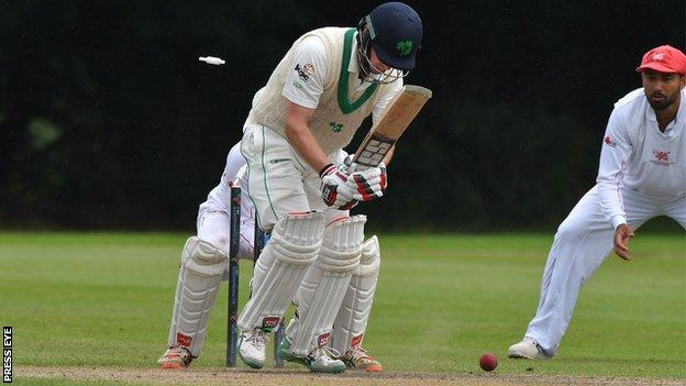 Ireland captain William Porterfield has to walk after being bowled by Eshan Khan