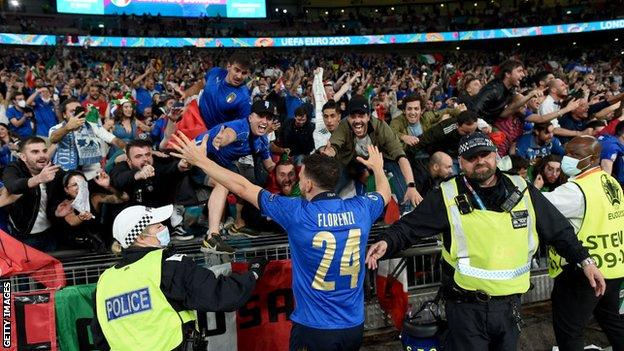 Italy fans celebrate their win at Wembley