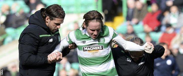 Celtic midfielder Stefan Johansen receives treatment on an injury