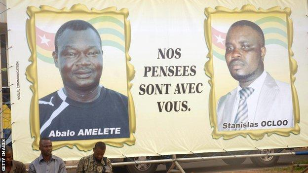 A billboard pays tribute to two of the victims - assistant coach Pascal Amalete Abalo Dosseh and media officer Stanislas Ocloo