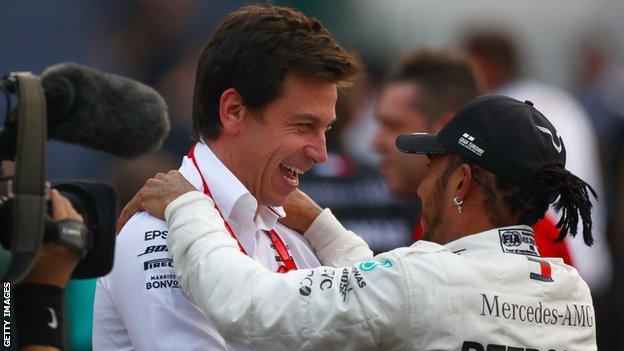 Lewis Hamilton embraces with Toto Wolff