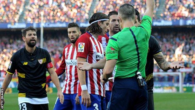 Seville defender Victor Vitolo is sent off against Atletico Madrid