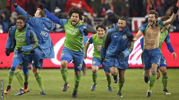 Roman Torres celebrates with his Seattle Sounders team-mates
