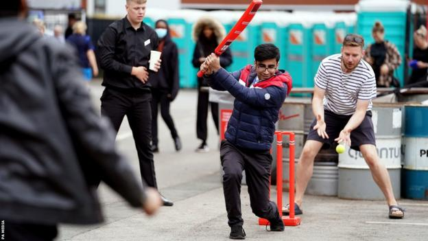 Fans play cricket at Emirates Old Trafford
