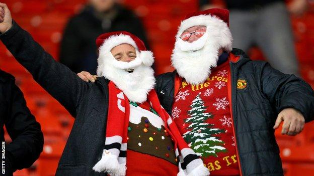 Football spectators wearing their festive jumpers