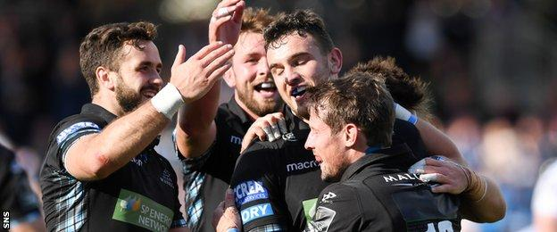 Glasgow Warriors celebrate a try from Adam Ashe