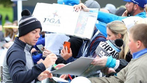 Rory McIlroy signing autographs at Bethpage Black