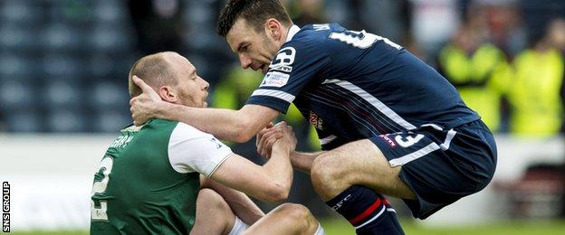 David Gray with Ross County's Paul Quinn