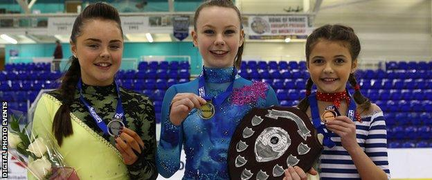 Christie Anne Shannon holds the British Championship trophy