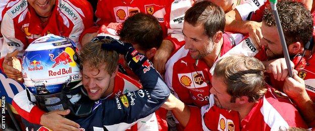 Sebastian Vettel and Daniel Ricciardo embrace