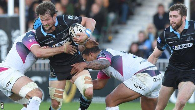 Peter Horne battles through the Ospeys' tackles as Richie Vernon offers support