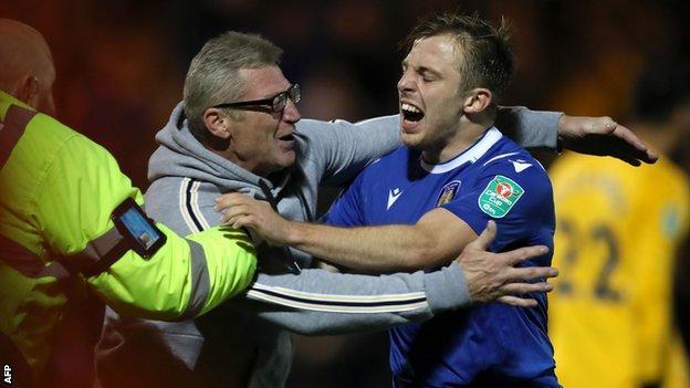 Tom Lapslie celebrates on the pitch