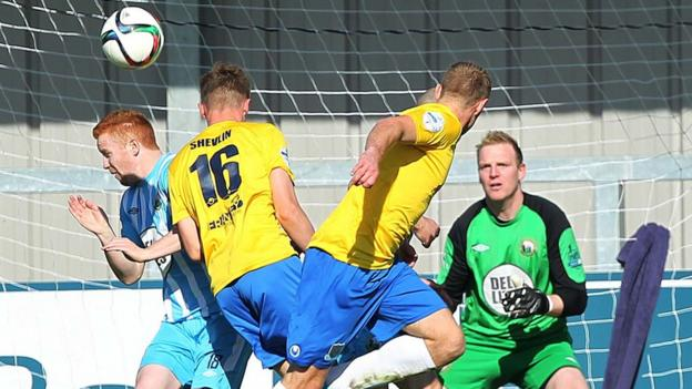Matthew Shevlin heads towards goal during Ballymena United's 2-1 victory over Warrenpoint Town at Milltown
