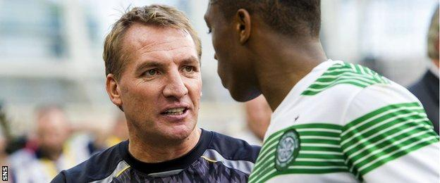 Brendan Rodgers shakes hands with Celtic youngster Darnell Fisher in August 2013