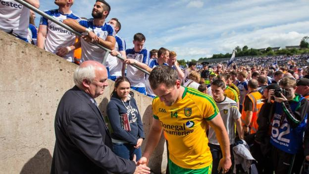 A disgruntled Donegal captain Michael Murphy leads his players off the pitch after their defeat in the Ulster decider