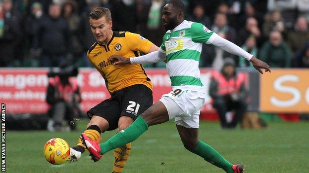 Newport County's Matt Partridge under pressure from Francois Zoko of Yeovil Town