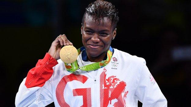 Nicola Adams holds her second Olympic boxing gold medal