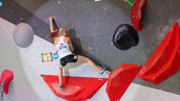 Janja Garnbret on the boulder wall at the Climbing World Cup