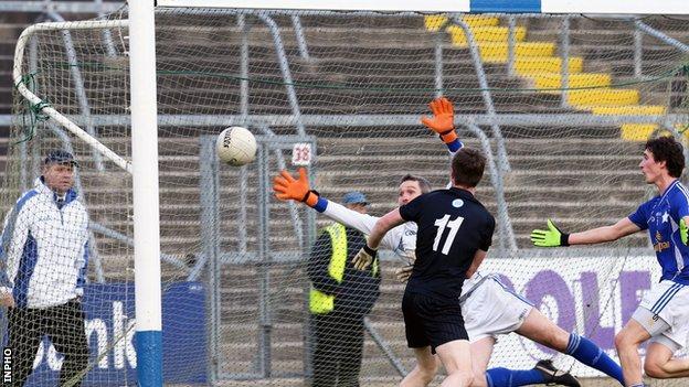 Paul Devlin fires in Kilcoo's opening goal against Kingscourt