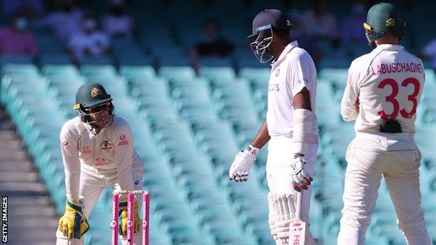 Australia captain Tim Paine (left) speaks to India's Ravichandran Ashwin (centre) during day five of the third Test in Sydney