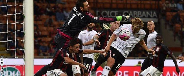 Oscar Hiljemark heads Palermo's first goal at Milan