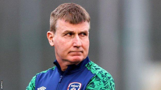 Republic of Ireland boss Stephen Kenny looks on during training