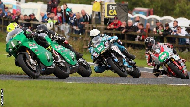 Ian Lougher leads the chasing pack during the first Supertwins race at the 2019 Ulster Grand Prix