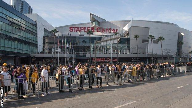 Thousands of Los Angeles Lakers fans line the streets outside the Staples Center during the Kobe and Gianna Bryant memorial service