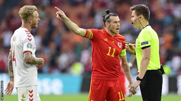Gareth Bale protests to referee Daniel Siebert following Denmark's second goal, which Wales felt should have been ruled out for a foul on Kieffer Moore