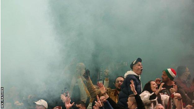 A flare goes off in the crowd in the Hungary section at Wembley