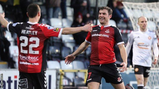 Philip Lowry celebrates his first goal against Portadown with Paul Heatley