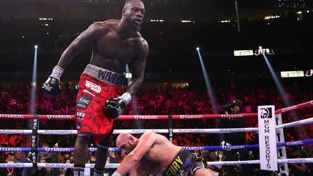 Deontay Wilder knocks down Tyson Fury