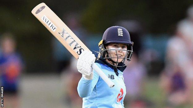 England opener Tammy Beaumont raises her bat so salute the crowd after passing 50 during the ODI series against New Zealand